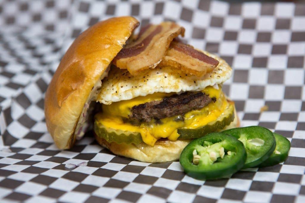 Big Ange's Signature Cheese Burger (w/extras: fried egg, bacon & jalapenos)